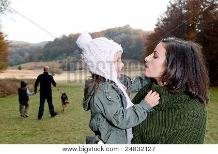 Family Having A Walk Outdoors