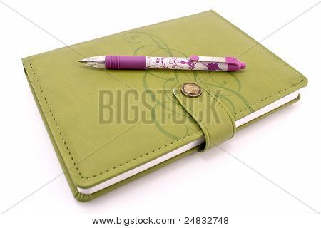 Pen And Green Notebook