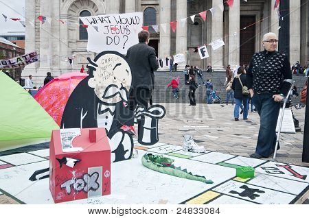 LONDON, UK -OCTOBER 31: Artwork donated to Occupy London protesters by famous Banksy outside St.Pail's Cathedral on October 31, 2011 in London.