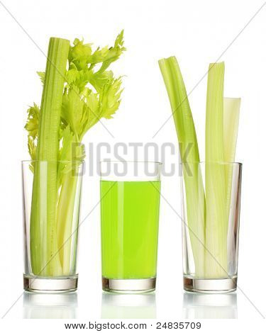 fresh green celery in a glass and juice isolated on white