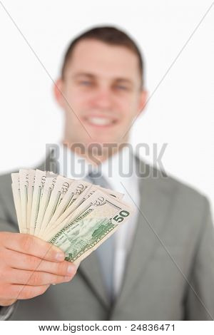 Portrait of a smiling businessman showing notes against a white background