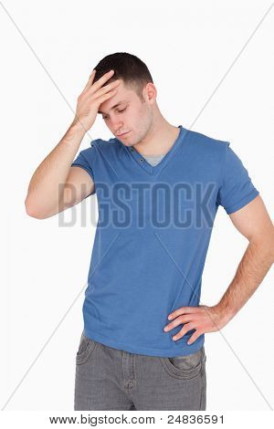 Portrait of a depressed man against a white background