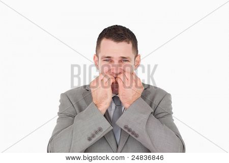 Nervous young businessman against a white background