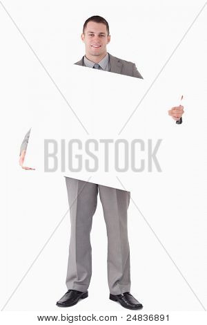 Portrait of a businessman holding a blank panel against a white background