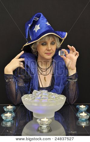 Witch In Blue Hat With Magic Crystals And Candles
