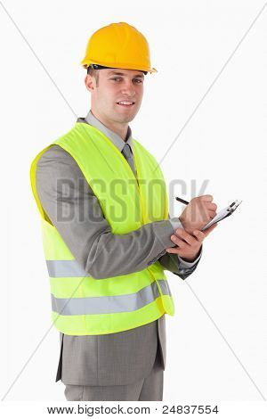 Portrait of a smiling builder holding a clipboard against a white background