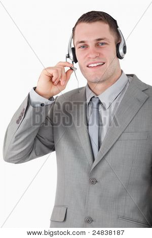 Portrait of a smiling operator using a headset against a white background