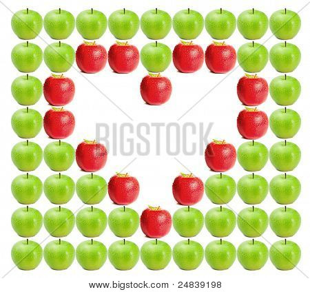 Green wet apples with red apples shaping a heart in between on a white background