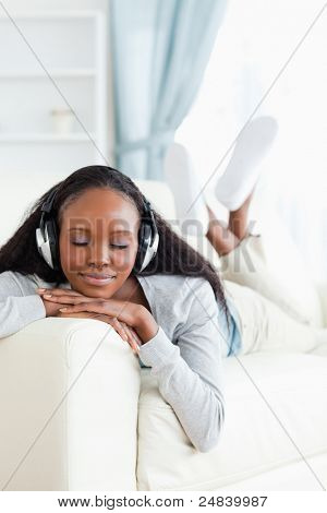 Young woman with eyes closed enjoying music