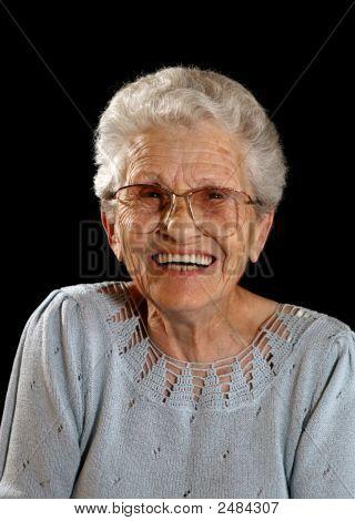 Smiling Happy Elderly Woman On Black