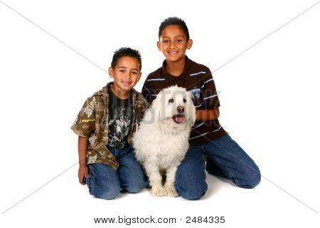 Two Boys With A White Dog