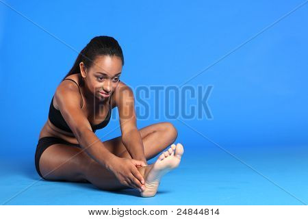 Hamstring And Back Stretch By Pretty African Woman