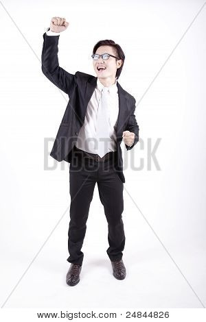 Asian Businessman Throwing Punch To The Air