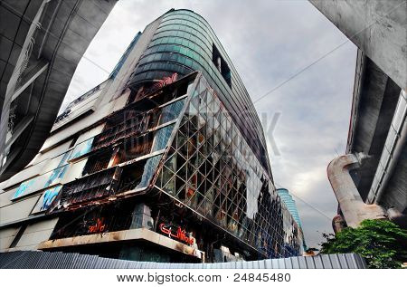 BANGKOK - JUNE 11: Fire damaged exterior of Central World Plaza shopping mall is seen in the aftermath of the anti government 'Red Shirt' protest on June 11, 2010 in Bangkok, Thailand