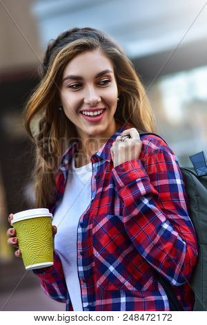 poster of Awesome Girl In Urban Style Walk In City With Coffee.