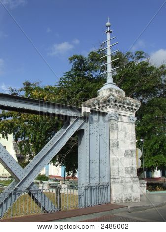 Column At One Side Of A Road Bridge Over A River In Matanzas