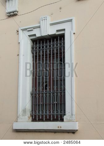 Colonial Building White Border Iron Window In Calle Medio