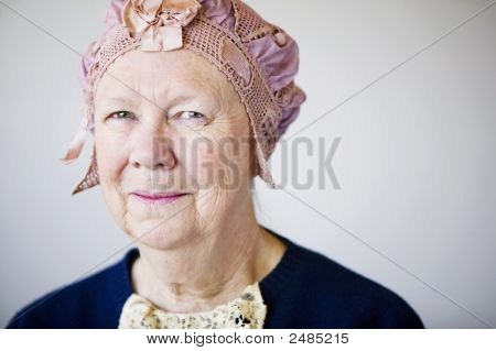 Smiling Senior Woman With A Vintage Hat