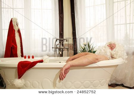 Santa Claus having a bath