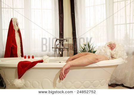 Santa Claus having a bath