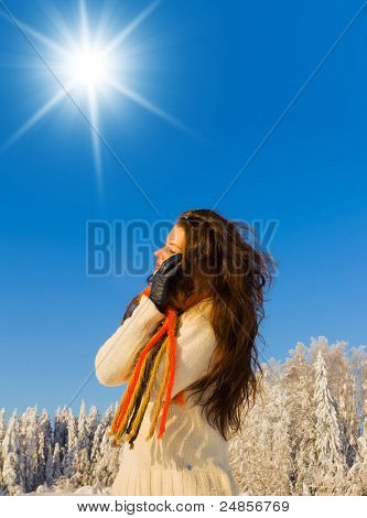 Beauty in warm clothes Enjoying the Snow