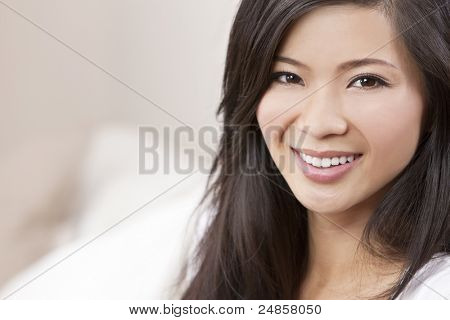 A beautiful young Chinese Asian Oriental woman with a wonderful toothy smile