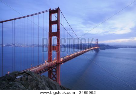 Golden Gate Bridge And Ruins Of Old Fortification At Sunset