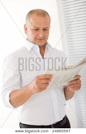 Senior Businessman Happy Read Newspapers Portrait