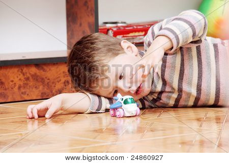 Little Boy Playing With Toy Helicopter