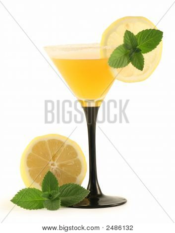 A Glass With A Cocktail And A Lemon