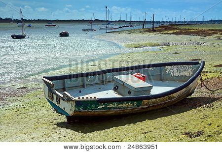 Small Boat At Low Tide