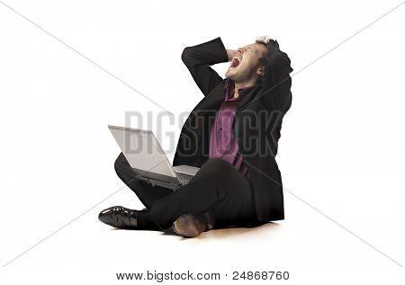 Screaming businessman using a laptop