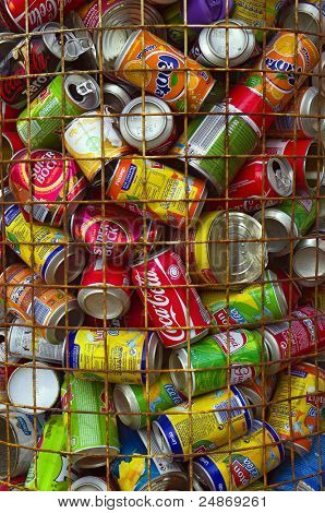 LISBON, PORTUGAL - OCT 1: Used aluminum cans are deposited into a container for recycling, this contributes to this year's new record of 290 tons of residue collected for recycling in Lisbon on Oct 1, 2011.