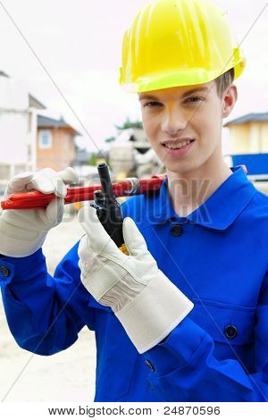 apprentice / trainee. construction worker on building site