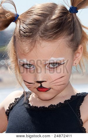 a child with kitty cat make up