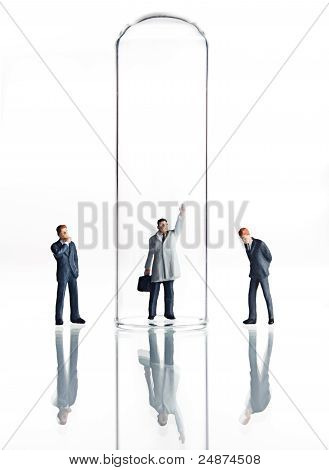 Business figurines and test tubes
