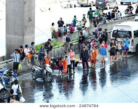 PHATHUMTRANI, THAILAND- OCTOBER 21: desperate people waiting for relocation during the worst flooding disaster   on October 21, 2011 Rongsit Road, Phathumtrani, Thailand.