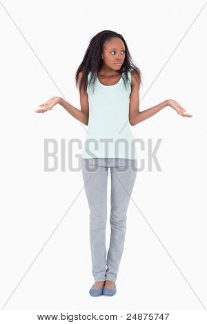 Young woman having no idea against a white background