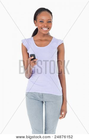 Close up of smiling woman writing text message on white background
