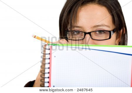 Female Student Writing On Notepad