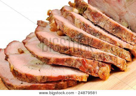 Roast pork on a wooden board