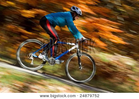 Autumn bike riding - intentional motion blur