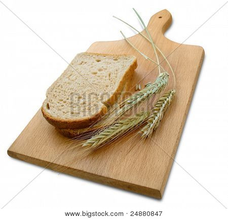 Rye ears (spikes) and loafs of bread on wooden board. Isolated, Clipping Path