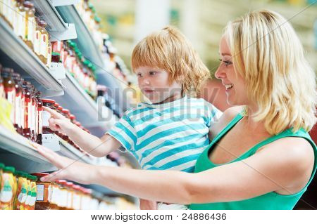 woman and child choosing produces in grocery shopping mall