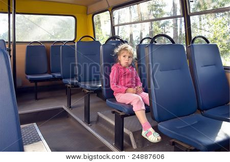 A girl in a bus.