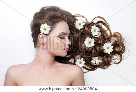 Camomiles In Hair Of Woman