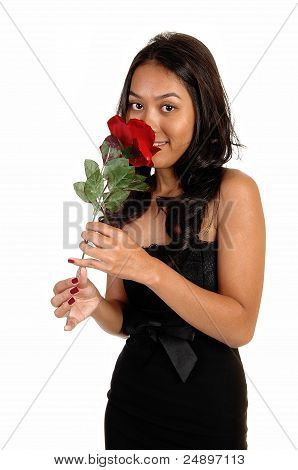 Girl Smelling Red Rose.
