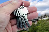 foto of real-estate agent  - real estate agent hands over the keys - JPG