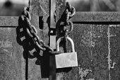 Old Lock. Padlock With Shackle And Locking Mechanism Closeup One Portable Lock On Chain On Unpainted poster