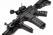 stock photo of m4  - Modern weapon series. US Army Spec Ops M4A1 custom build assault carbine with RIS/RAS red dot sight and tactical flashlight. 